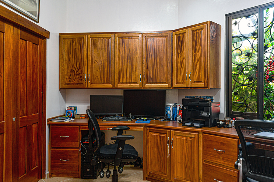Custom framed wood office cabinets for working from home from a home office