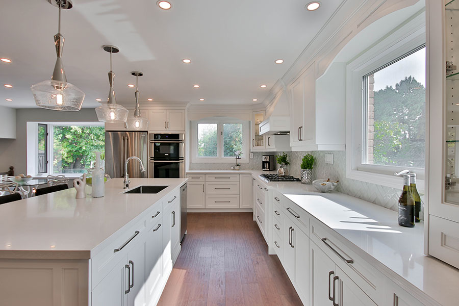 Beautiful white kitchen with framed cabinets